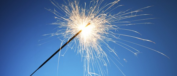 Sparkler on blue background
